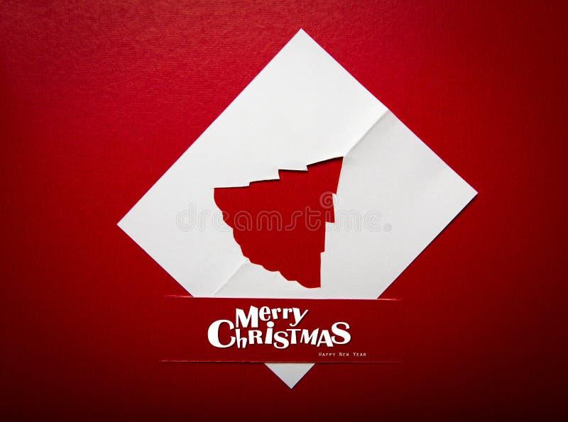 Cartão de Natal com a decoração do Natal do origami. fotos de stock royalty free