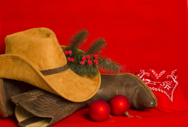 Cartão de Natal do cowboy Botas e chapéu tradicionais ocidentais americanos sobre fotografia de stock
