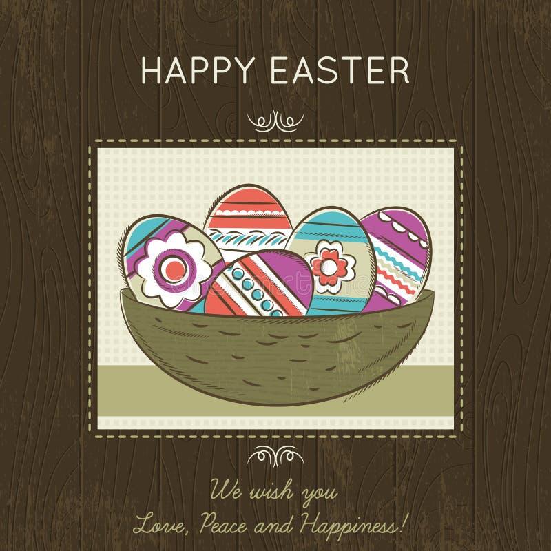 Cartão de Páscoa com o ninho completo de ovos coloridos no fundo de madeira ilustração royalty free