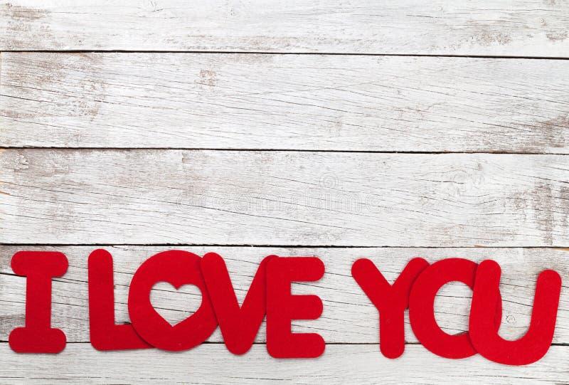 Cartão do dia de Valentim com eu te amo palavras imagem de stock