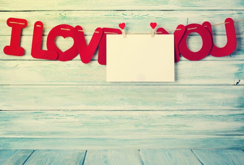 Cartão do dia de Valentim com eu te amo palavras foto de stock royalty free