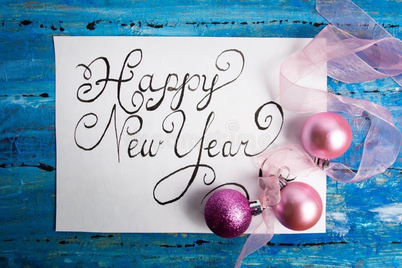 Cartão do feriado da caligrafia do ano novo feliz imagem de stock royalty free