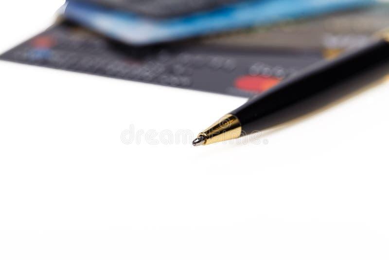 Cartão e pena de crédito foto de stock