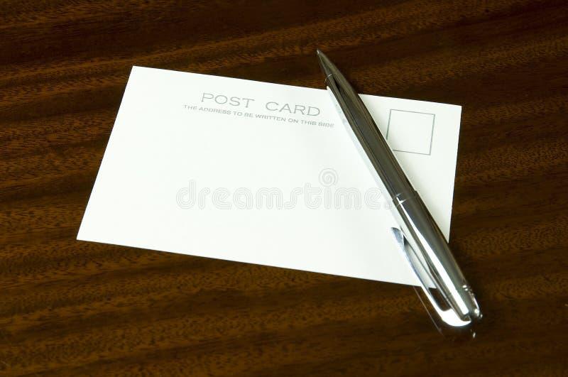 Cartão e pena em branco fotografia de stock royalty free