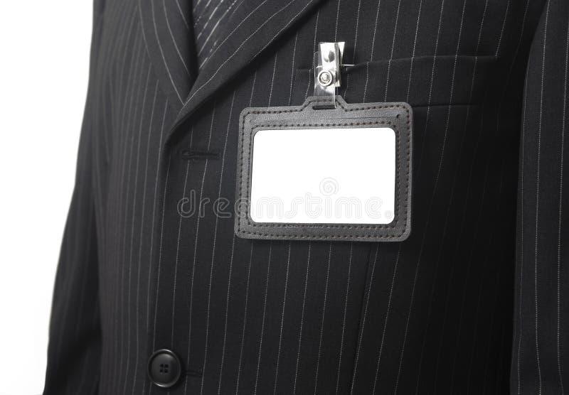 Cartão em branco da identificação no terno imagem de stock royalty free