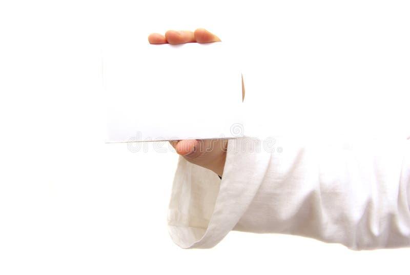 Cartão em branco em uma mão foto de stock