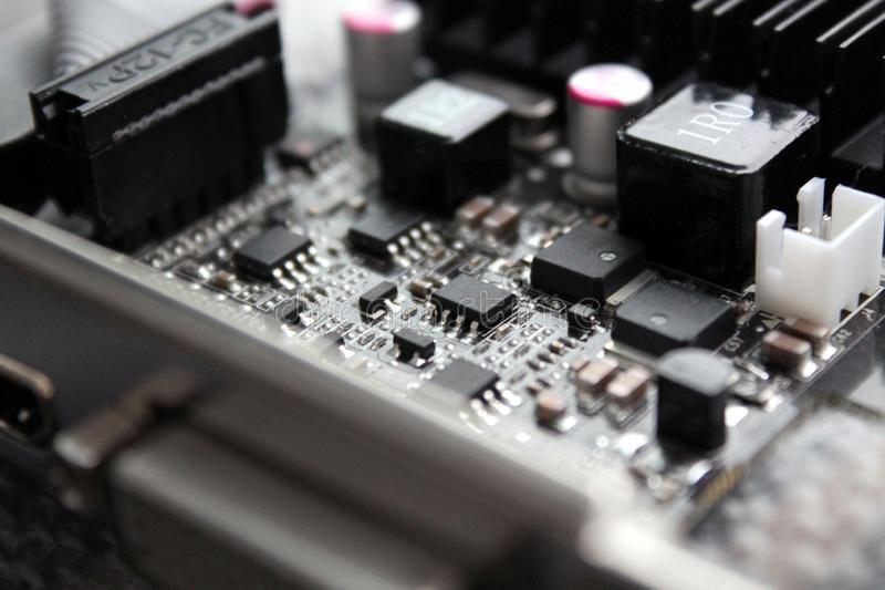 Cartão-matriz da microeletrônica do material informático do close-up fotografia de stock