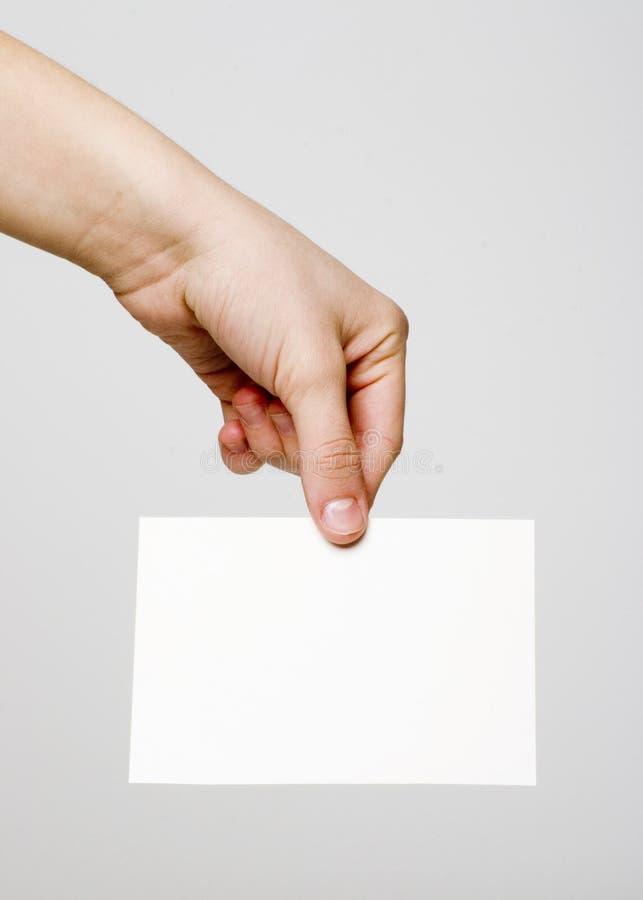 Cartão na mão foto de stock