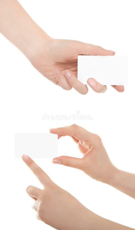 Cartão na mão da mulher foto de stock royalty free
