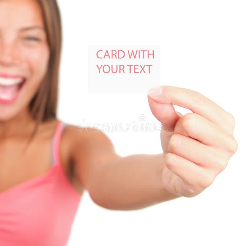 Cartão que mostra por mulher excited foto de stock royalty free