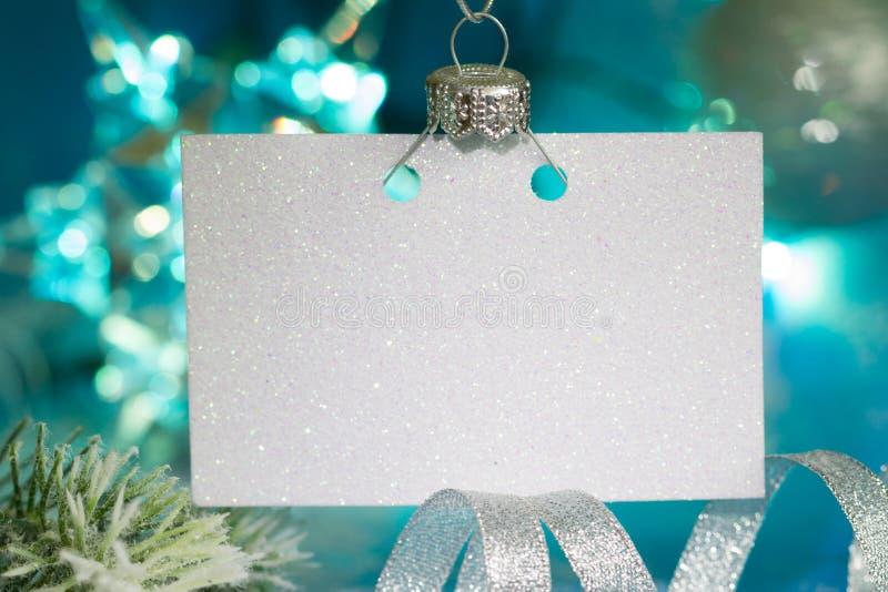 Cartão vazio do Natal e de decoração do ano novo conceito azul de prata do fundo do sumário fotos de stock