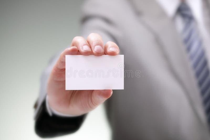 Cartão vazio em uma mão fotografia de stock royalty free