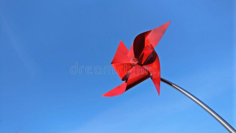Cartão vermelho do moinho de vento imagem de stock royalty free