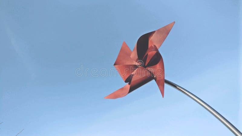 Cartão vermelho do moinho de vento fotografia de stock royalty free