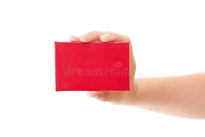 Cartão vermelho na mão humana imagem de stock royalty free
