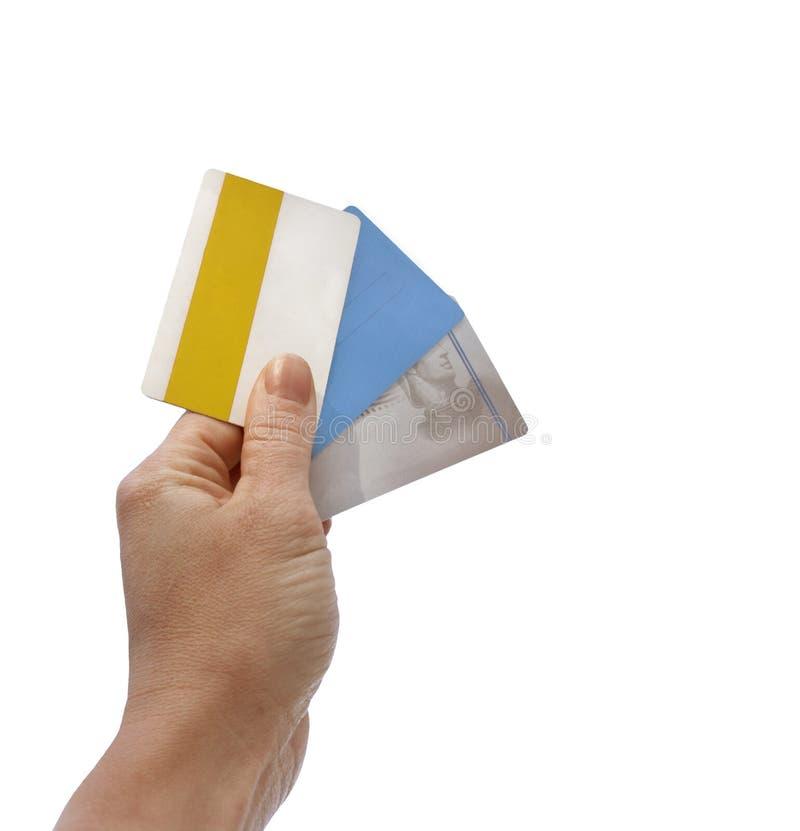 Cartões da mão e de crédito imagens de stock royalty free