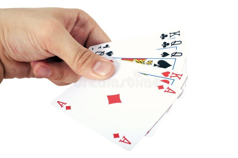 Cartões da mão e de jogo isolados no branco imagens de stock