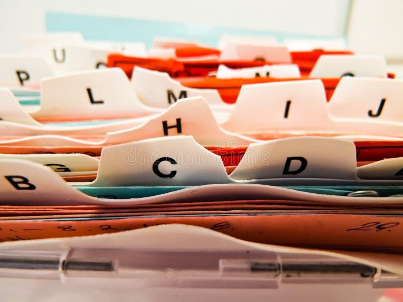 Cartões de deslocamento predeterminado alfabético. Dados do cliente no ABC imagem de stock