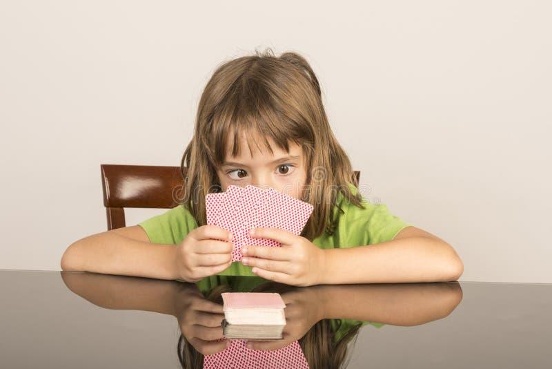 Cartões de jogo da menina fotografia de stock