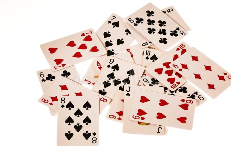 Cartões de jogo do close up isolados no fundo branco fotos de stock royalty free