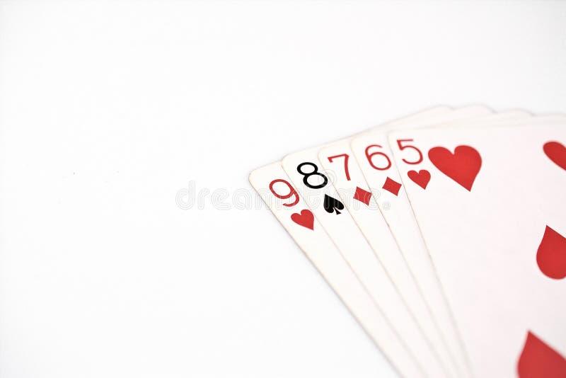 Cartões de jogo do grupo de símbolo das classificações da mão de pôquer no casino: diretamente fundo branco, sumário da sorte imagem de stock