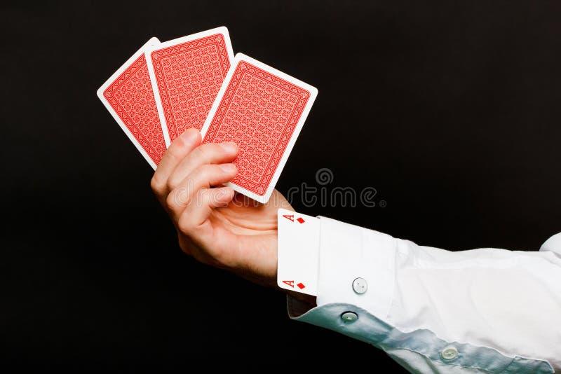 Cartões de jogo e um ás no furo fotos de stock