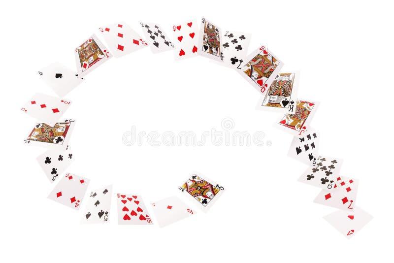 Cartões de jogo que voam em uma espiral Isolado no fundo branco fotografia de stock