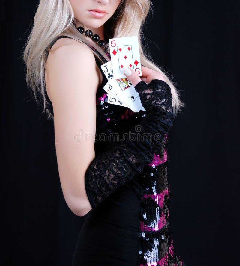 Cartões de jogo 'sexy' da terra arrendada da mulher fotografia de stock royalty free