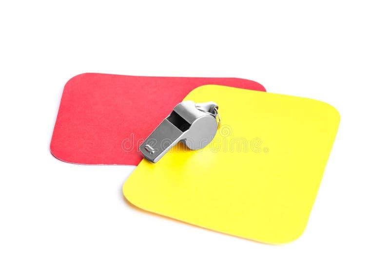 Cartões do assobio, os vermelhos e os amarelos fotografia de stock