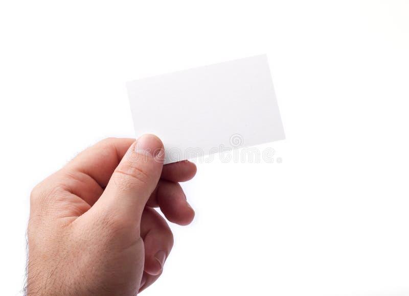 Cartões isolados na terra arrendada branca nas mãos imagem de stock