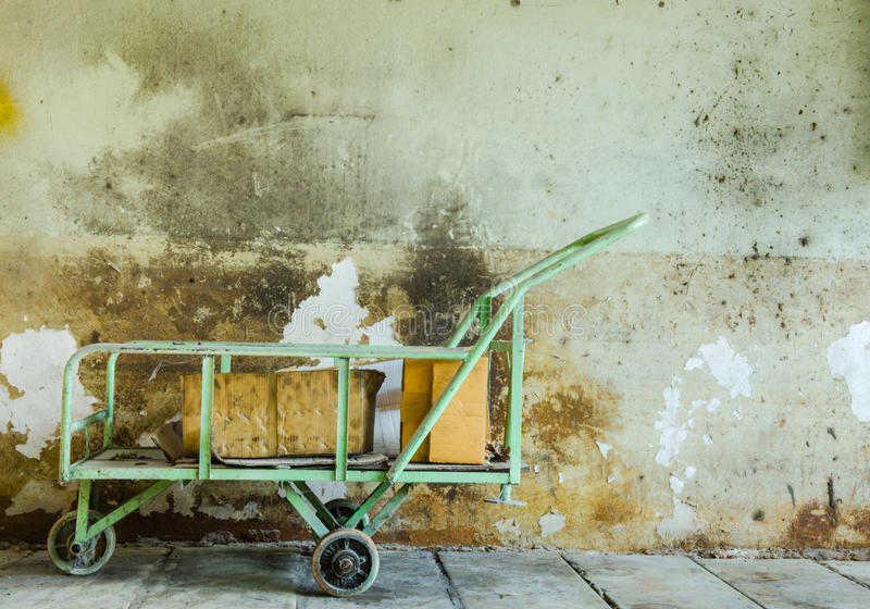 Cart on cement wall and dirty stock image