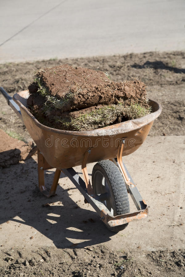Cart full of new lawn sod. A new lawn building in the yard of house background stock image