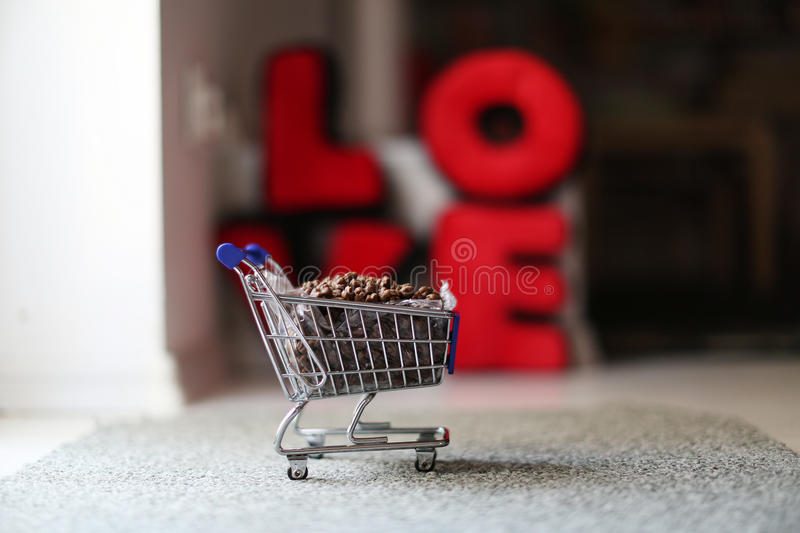 Cart full of pet food. Pet food in a shopping cart, supermarket buy royalty free stock photography