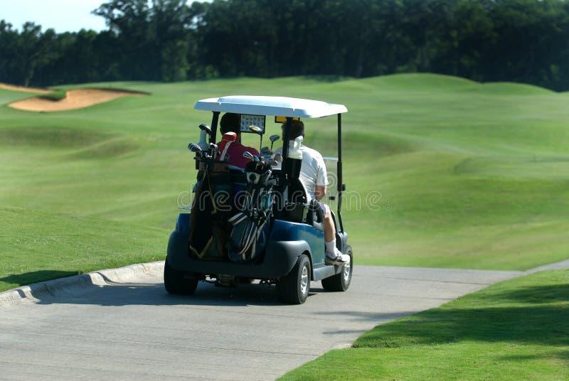cart golfare royaltyfria bilder