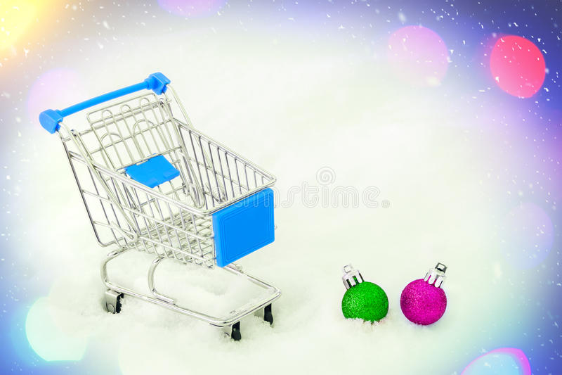 Cart from the grocery store on snow. Concept of winter shopping. New Year and Christmas buying. stock photography