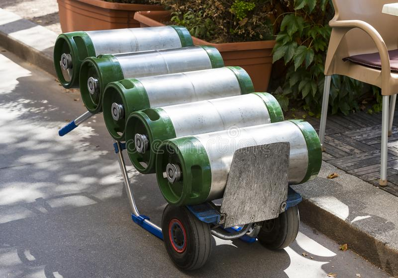 A cart loaded with kegs and beer. On a city street stock photos