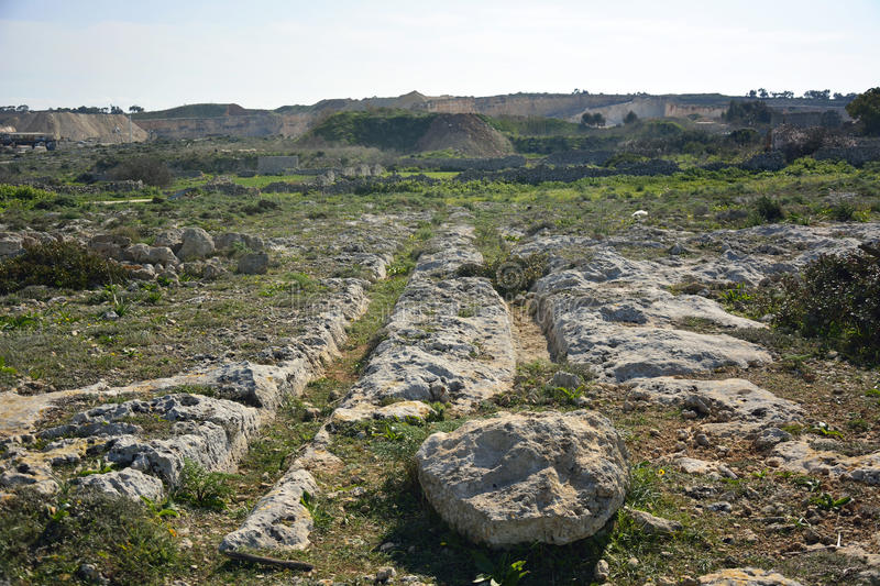 Cart ruts in Malta. Parallel grooves of prehistoric cart ruts, mysteriously scored into the rock at Clapham Junction in Malta stock image
