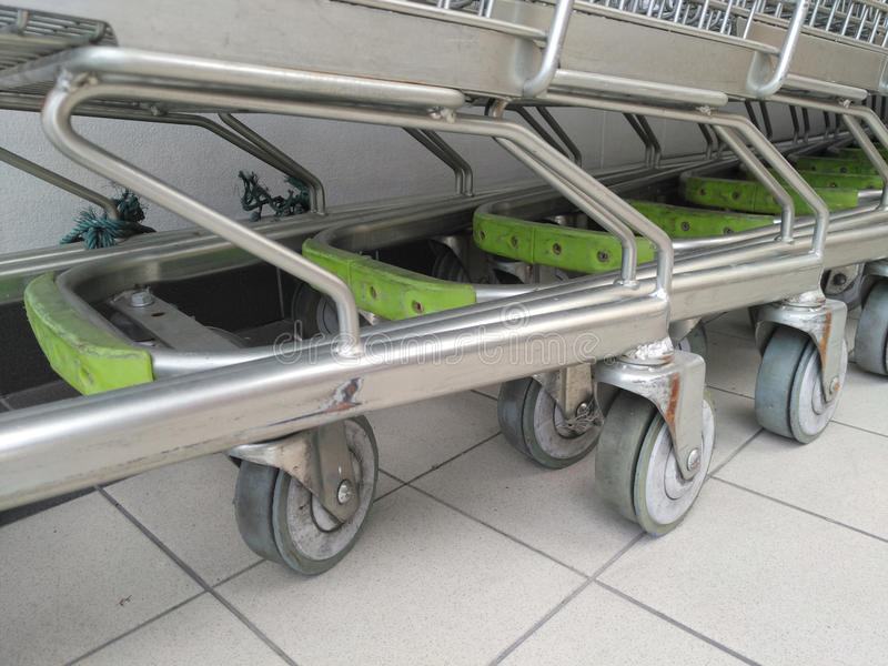 Cart several rows combine in shops supermarkets. Cart basket chrome several rows together in shops supermarkets royalty free stock photo