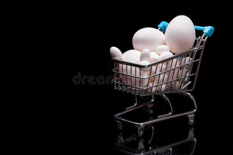 The cart from a supermarket full of eggs. Space for text. Preparation for Easter royalty free stock photo