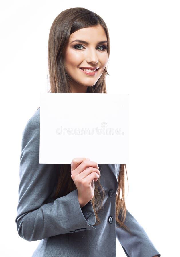 Carta in bianco bianca della tenuta della donna di affari fotografia stock