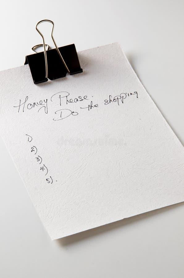 Carta da lettere per la lista di acquisto fotografie stock