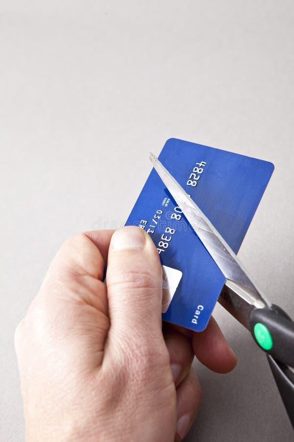 Carta di credito che è tagliata immagine stock libera da diritti