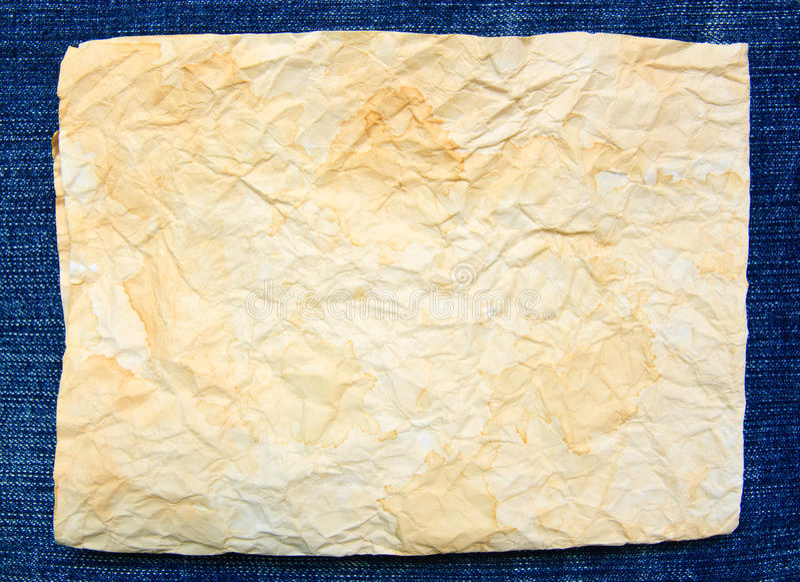 Carta di lerciume su struttura del tessuto delle blue jeans immagine stock