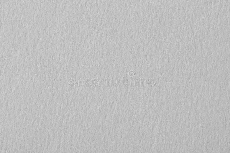 Carta strutturata grigia calda in bianco con le particelle per progettazione-uso immagini stock libere da diritti