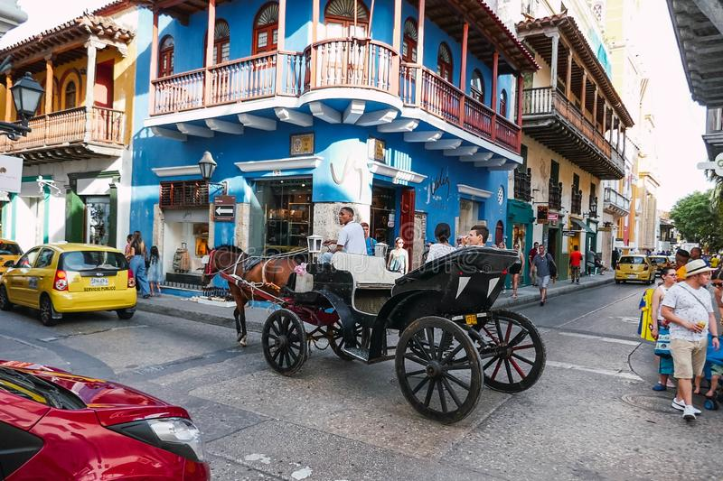 Cartagena, Colombia - August 5, 2019: a horse-drawn carriage on a street in the city of Cartagena de Indias stock photos