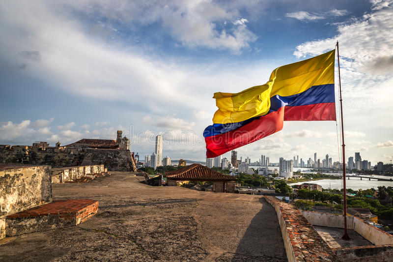 Cartagena, Colombia - The Colombian flag in the Cartagena Fort in a cloudy and windy day. Cartagena, Colombia stock image