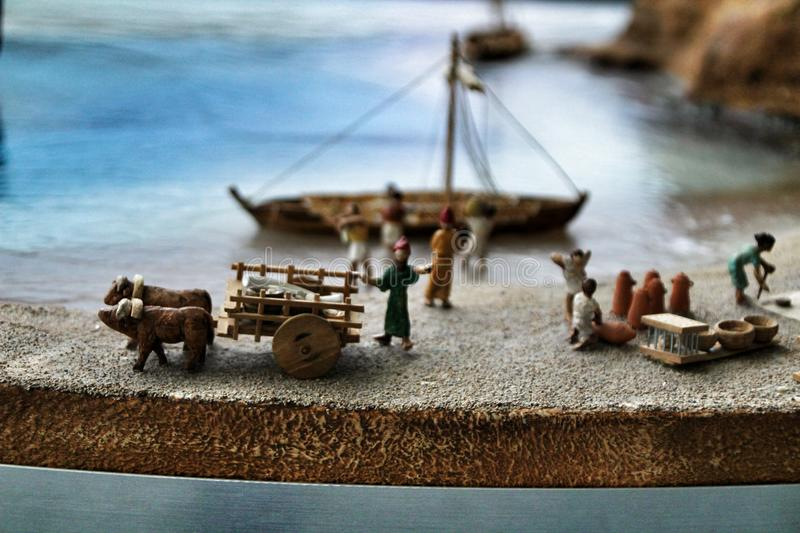 Miniature roman figurines reflecting daily life in roman times stock image