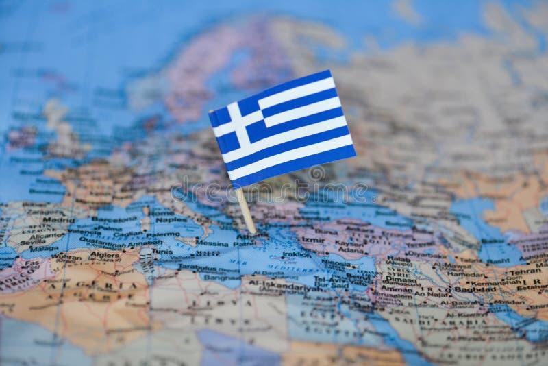 Le Drapeau De La Grèce Dans La Carte Du Monde Image Stock
