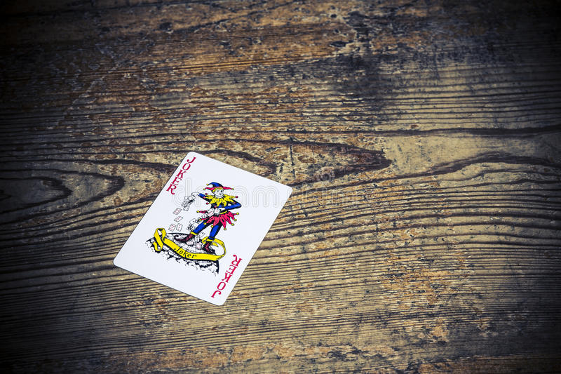 Carte avec le joker image stock