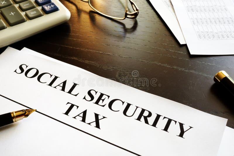 Carte con la tassa di sicurezza sociale fotografia stock